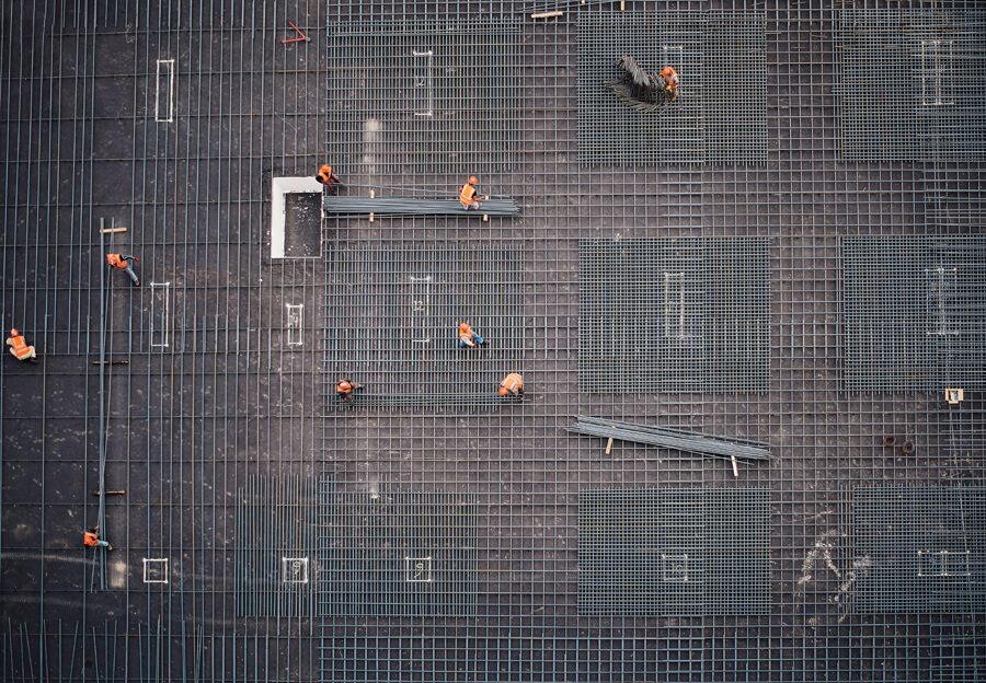 Arial view of construction workers preparing to pour concrete.