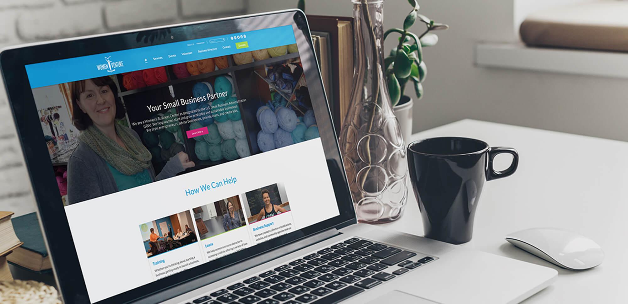 Laptop featuring WomenVenture's website