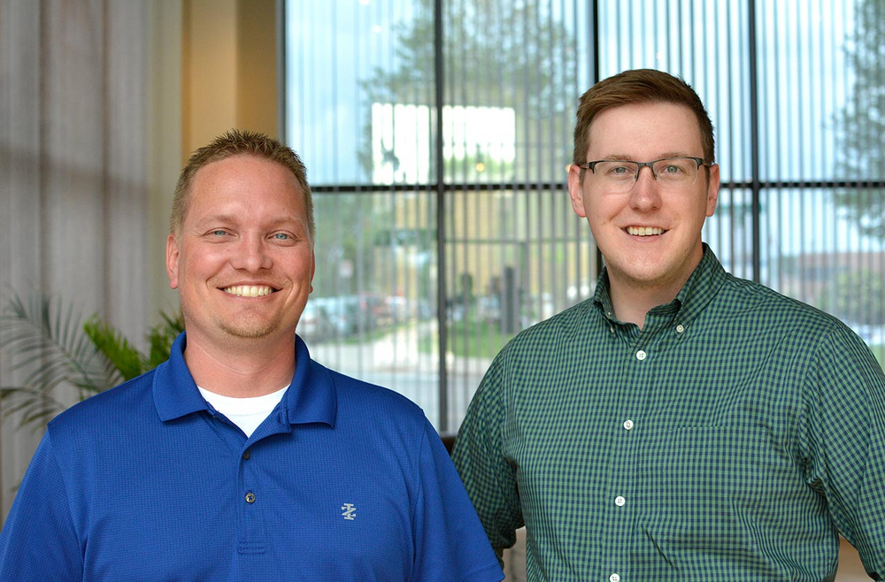 Corey Sader (Front-End Web Developer) and Brian Miller (Web Designer) at Plaudit Design